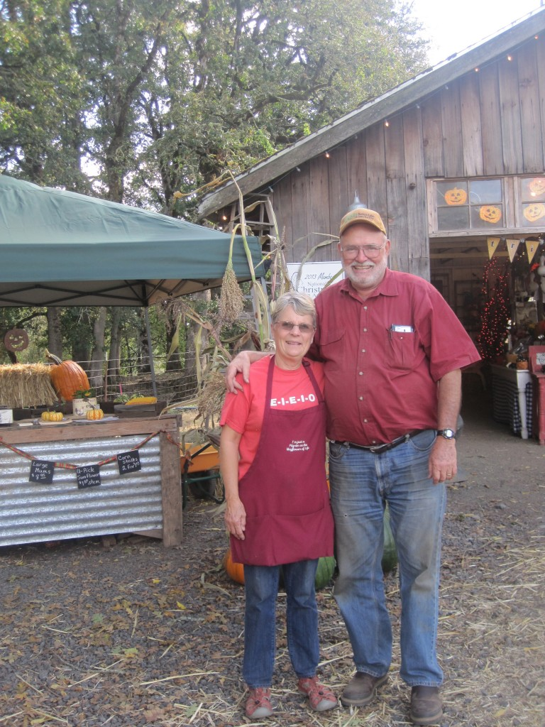 Bob and Lynn Schutte, owners of Northern Lights Christmas Tree Farm, in front of their farm stand.  Photo by Vanessa Salvia