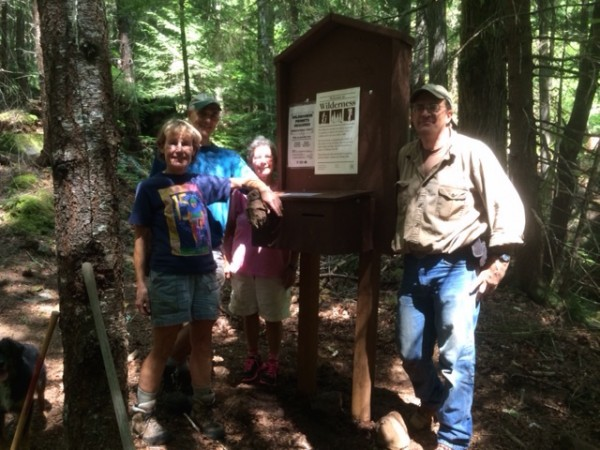 Jan Anselmo, Rich Anselmo, Rhonda Levine and Mike Kinyon next to the Black Creek Trailhead sign they assembled and placed. Photo by Judy Mitchell