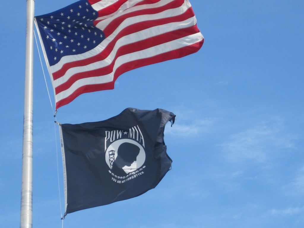 The American flag and the POW-MIA flag fly in a brisk breeze outside of the Eugene Elks Lodge. Photo by Vanessa Salvia