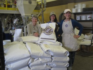 From left to right, Stephanie Powers, assistant miller Elizabeth Hayes, and distribution manager Sarah Adkison. Photo by Vanessa Salvia