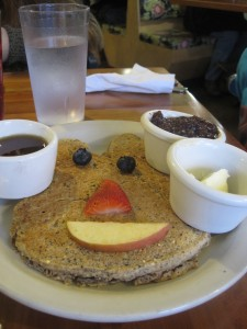 The Kid's Pancake comes with either a multigrain or sesame-spelt (wheat free) pancake served with blueberry-apple compote. Photo by Vanessa Salvia