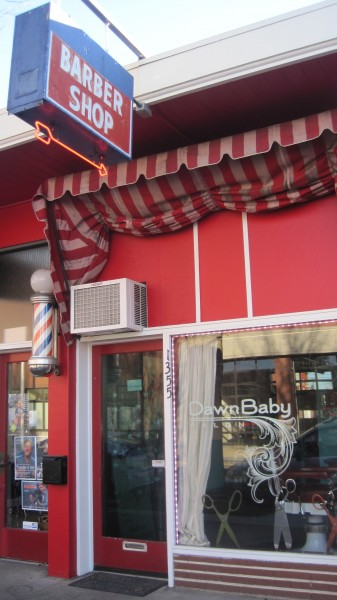 The building that houses Dawn Baby Salon was formerly Johnny's Barber Shop. That spot has been a barber shop for 85 years, as long as the building's been existence. Photo by Vanessa Salvia